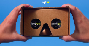 Screenshot of two hands holding Google Cardboard at the website nytimes.com/vr